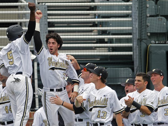 Vanderbilt's Dansby Swanson (7) and Xavier Turner (9) celebrate with teammates after scoring during the first inning of an NCAA college baseball Super Regional tournament game against Stanford Friday, June 6, 2014, in Nashville, Tenn. (AP Photo/Wade Payne)