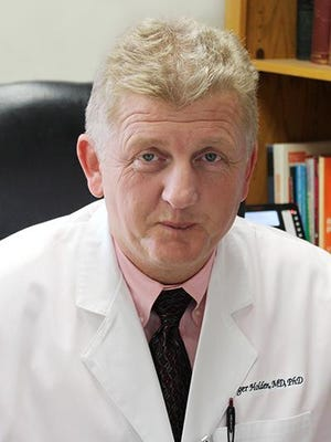 Dr. Roger Holden