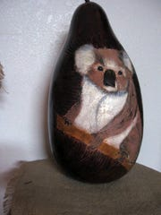 A cute Koala Bear that has been designed and finely handpainted by Betty Day on a gourd