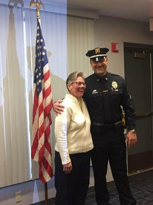 Colchester First Selectman Mary Bylone with Sgt. Tim Edwards.