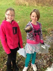Granton third-grade students went on a scavenger hunt to find rocks with different properties. This rock had to be bigger than the palm of their hand. Pictured are Abigail S. and Anna K. in the outdoor classroom being Granton School.