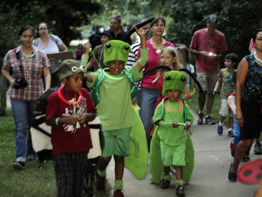 "Children dressed up for an insect parade during the annual  ""Insects of the Night"" at Warner Park"