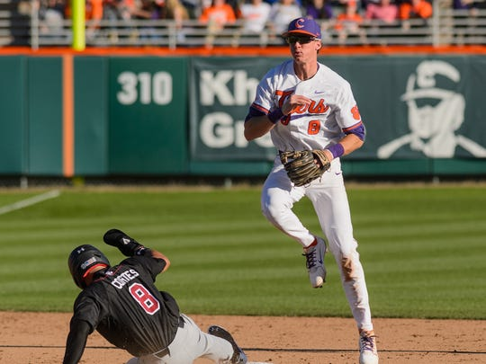 Clemson short stop Logan Davidson (8) turns a double
