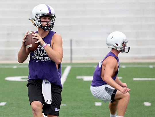 Elder quarterback Michael Bittner practices with the
