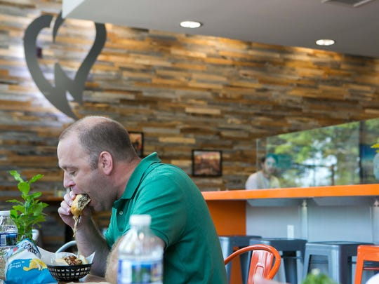 Bill Taylor of West Chester enjoys his lunch at WiLDWiCH