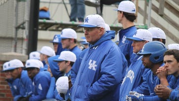 UK head coach Gary Henderson and players look on from the dugout in Kentucky's 5-1 win over Buffalo on March 4, 2016.