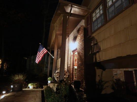 A flag flies at Owen and Rosemarie Lennon's Pomona
