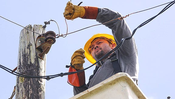 Guam Power Authority lineman electrician Cliff Raphael repairs the neutral line on a utility pole servicing residents in Yigo in this file photo.