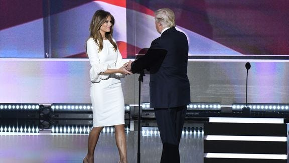 Donald Trump greets his wife, Melania Trump, on stage during the 2016 Republican National Convention at Quicken Loans Arena in Cleveland on July 18, 2016.
