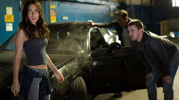"""Megan Fox (left) play April O'Neil, and Stephen Amell plays Casey Jones in a scene from """"Teenage Mutant Ninja Turtles: Out of the Shadows."""""""