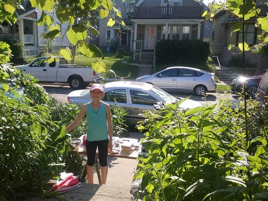 Lilia Graves, 11, staged a yard sale outside her Riverwest