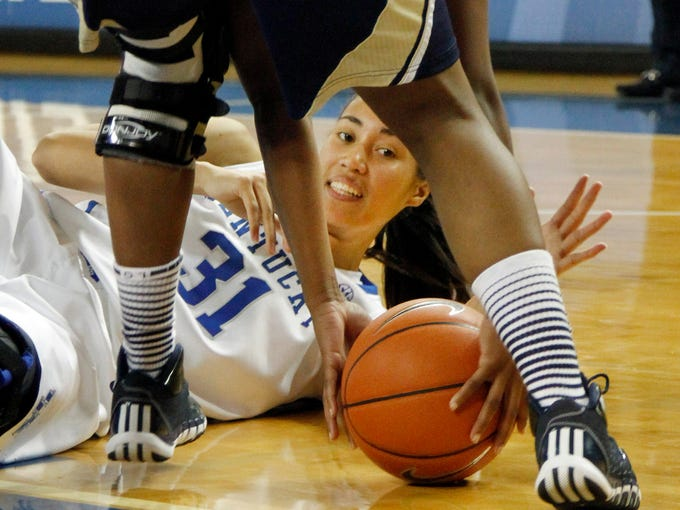 Kentucky's Samantha Drake tries to steal the ball from Georgia Southern's Sierra Kirkland during the second half of an NCAA college basketball game, Wednesday, Nov. 13, 2013, in Lexington, Ky. Kentucky won 103-38. (AP Photo/James Crisp)