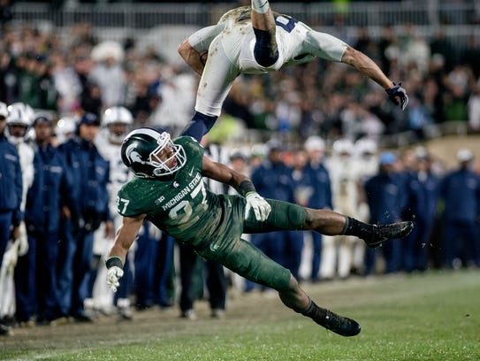 Penn State's Mike Gesicki leaps over Michigan State's