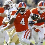 Nov 15, 2014; Atlanta, GA, USA; Clemson Tigers quarterback Deshaun Watson (4) runs with the ball against the Georgia Tech Yellow Jackets in the first quarter at Bobby Dodd Stadium.