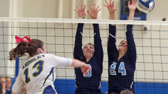 Westlake's Antonia Perino (9) and Kelly Martin (24) block Ardsley's Marie McNerney (13) shot during Section 1 Class B girls volleyball semifinal against Ardsley at Westlake High School in Thornwood Nov. 3, 2016.