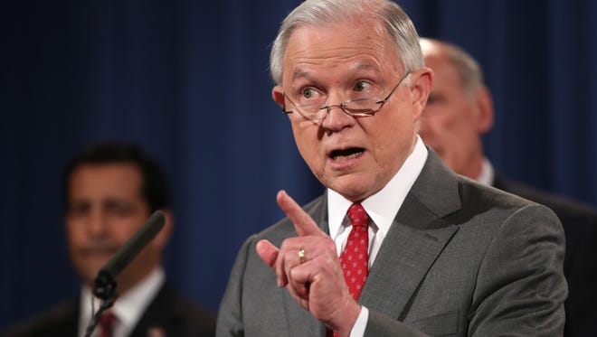 Attorney General Jeff Sessions speaks during a news conference Aug. 4, 2017 at the Justice Department in Washington.