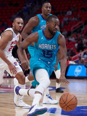 Oct 4, 2017; Detroit, MI, USA; Charlotte Hornets guard Kemba Walker moves the ball during the first half against the Detroit Pistons at Little Caesars Arena.