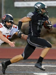 West Salem's Anthony Gould (15) rushes past Sprague's Taylor Blea (25) for a touchdown in the first half of the Sprague vs. West Salem football game at West Salem High School on Friday, Sept. 8, 2017.