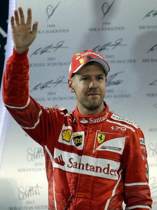 FILE - In this Sunday, Nov. 26, 2017 file photo Ferrari driver Sebastian Vettel of Germany waves to supporters after the Emirates Formula One Grand Prix at the Yas Marina racetrack in Abu Dhabi, United Arab Emirates. Ferrari has paid special attention to aerodynamics for its new Formula One car, the SF71H model presented in Maranello, Italy, Thursday, Feb. 22, 2018 in an attempt to keep up with rival Mercedes on high-speed circuits. (AP Photo/Luca Bruno, file)