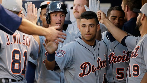 Jose Iglesias is greeted in the dugout after scoring a run in Tuesday night's game against the Yankees.