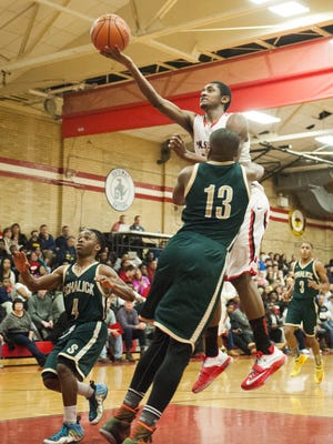 Saleem Little of Paulsboro goes airborne for a layin