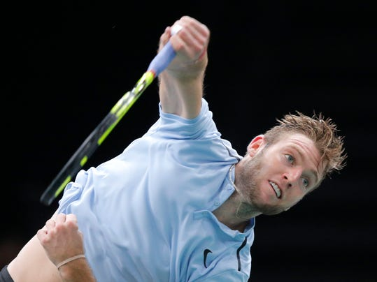 Julien Benneteau of France returns the ball to Jack Sock of the United States during their semifinal match of the Paris Masters tennis tournament at the Bercy Arena in Paris, France, Saturday, Nov. 4, 2017. (AP Photo/Michel Euler)