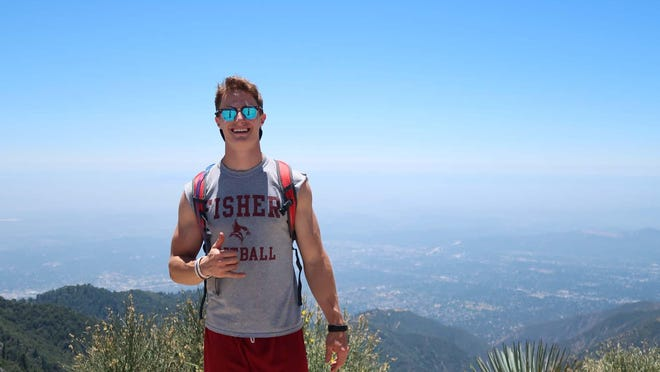 """Brennan Thompson, pictured, and his friend Garrett are hiking 12 mountains in California to help raise money for their hometowns in New York. Their effort is called """"Valley Tough."""" For Thompson, a 2015 Herkimer High School graduate, he is raising money for Catholic Charities of Herkimer County and the Herkimer High School athletics program. Thompson is pictured on the summit of Mount Wilson, in California, as part of the initiative."""
