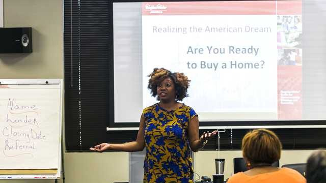Kendra Love teaches during a homebuyer education class at United Housing Wednesday. A Vanderbilt study finds that moderate and low income homeowners who first take a home buyers education course stand a much better chance of not getting foreclosed upon. (Yalonda M. James/The Commercial Appeal)