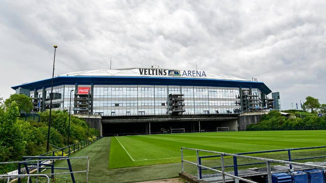 Rain clouds draw over the stadium Veltins Arena and the rolled out pitch of Bundesliga club FC Schalke 04 in Gelsenkirchen, Germany on April 29. Despite a ban in Germany on all large gatherings through the end of August to fight the coronavirus pandemic, soccer officials are hoping to restart the league without spectators in May.