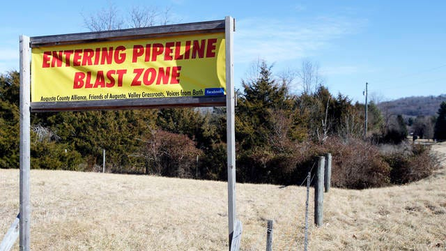 This Feb. 8, 2018 file photo shows a sign along a highway to protests the route of the Atlantic Coast Pipeline in Deerfield, Va. The developers of the Atlantic Coast Pipeline announced Sunday that they are canceling the multi-state natural gas project, citing delays and increasing cost uncertainty.