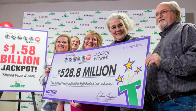 From left, Powerball winners Tiffany Robinson and her mother Lisa Robinson, Rebecca Hargrove, Tennessee Lottery President & CEO, and Powerball winner John Robinson, hold a check during a press conference at the Tennessee Lottery office Friday, Jan. 15, 2016, in Nashville, Tenn.