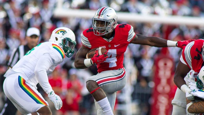 Sep 12, 2015; Columbus, OH, USA; Ohio State Buckeyes running back Curtis Samuel (4) runs the ball in the second half of the game against the Hawaii Warriors at Ohio Stadium. Ohio State beat Hawaii 38-0. Mandatory Credit: Trevor Ruszkowski-USA TODAY Sports