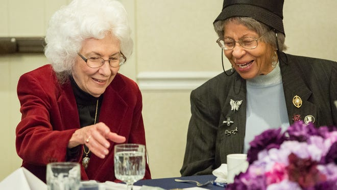 Dorothy Rachele, left, and Dorris T. Hamilton chat while eating breakfast together on Monday January 16, 2017 during the Doña Ana County NAACP annual Martin Luther King Breakfast at Hotel Encanto de Las Cruces.