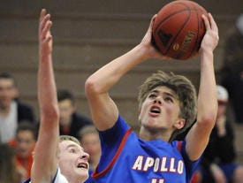 St. Cloud Apollo basketball player Cole Johnson is a returning starter. He fired up a shot in a game Jan. 11.