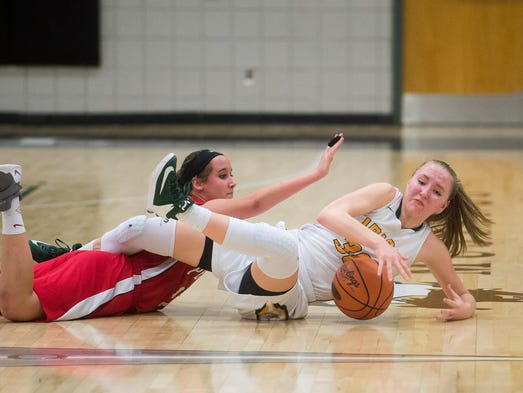 York Catholic's Katy Rader (right) holds onto a loose