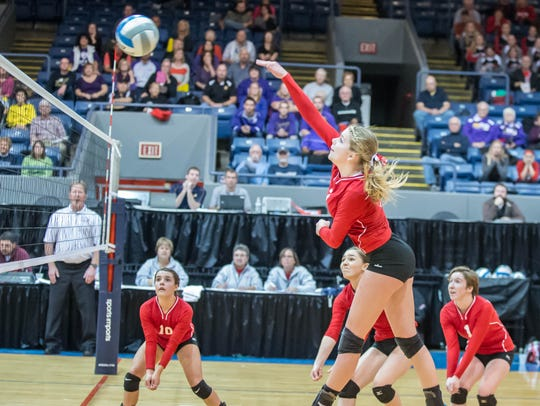 St. Philip's Abby McKinzie gets a kill against Plymouth