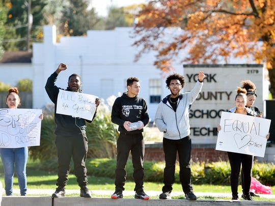 York County School of Technology students stand outside the school in protest of alleged racially motivated harassment at the school the day after the U.S. presidential election Friday, Nov. 11, 2016, on the corner of South Queen Street and Pauline Drive. A video circulated Wednesday showing students carrying a Donald Trump campaign sign inside the school, and allegations of other incidents, such as students of color being spat on and called racial slurs, later surfaced.
