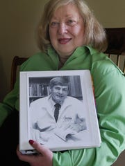 Elaine Kirchgatter, who died Thursday, holds a picture of her late husband Richard during her years in Canton.