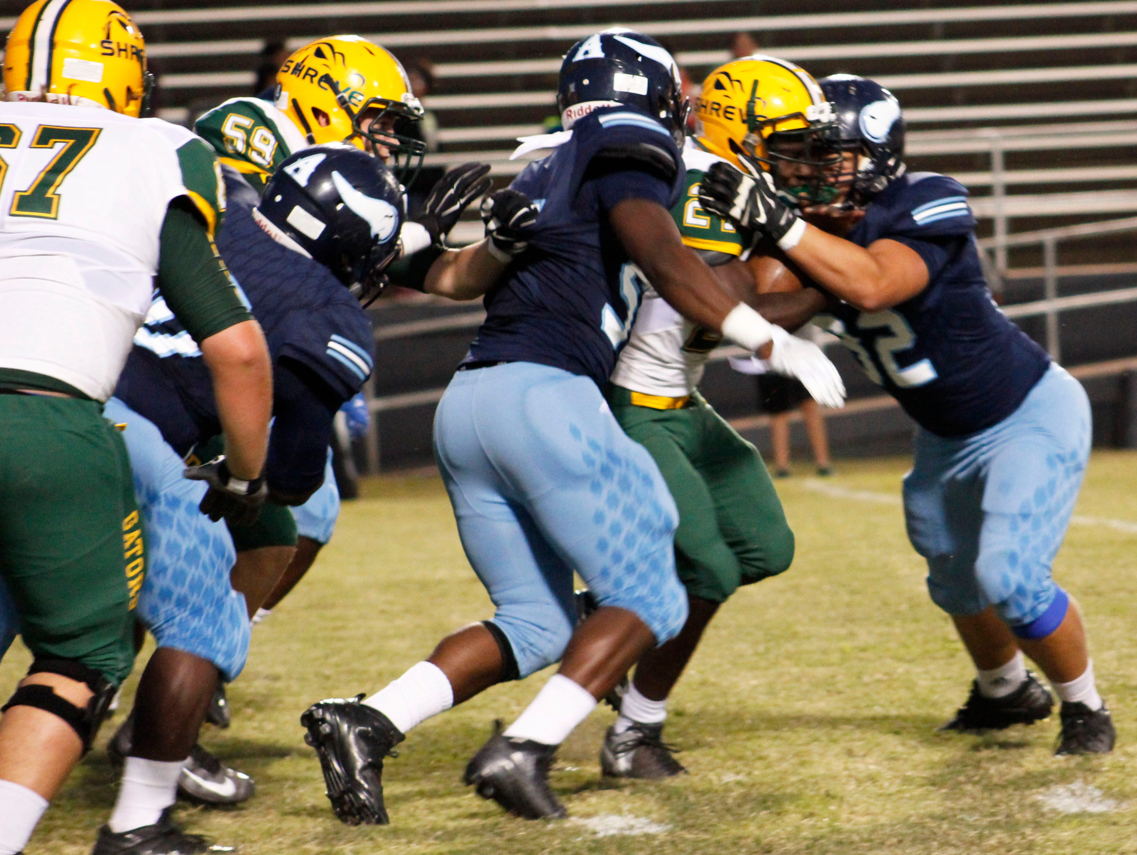 The Airline defense tries to wrap up Captain Shreve's Demarcus McCall during Friday's game.