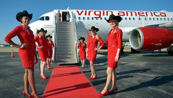 Virgin America flight attendants line a red carpet
