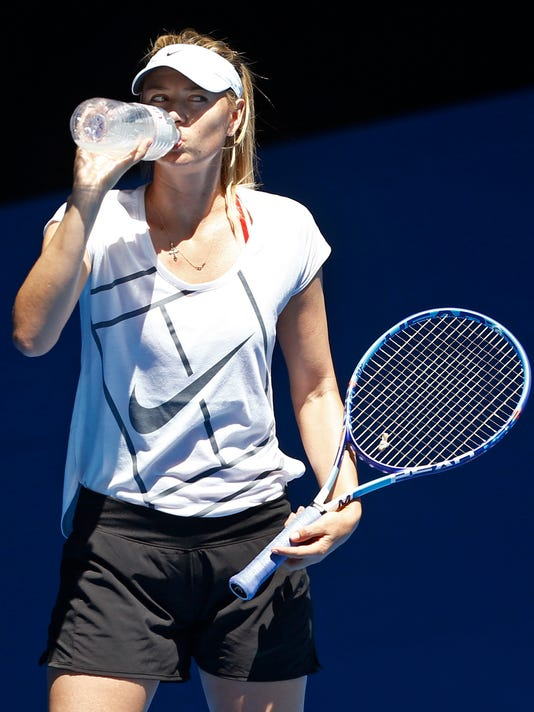 Russia's Maria Sharapova takes a drink during a practice session, ahead of the Australian Open tennis championships in Melbourne, Australia, Sunday, Jan. 17, 2016.(AP Photo/Vincent Thian)