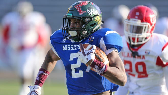 Mississippi's Marcus Murphy (2) carries for a gain in the fourth quarter in the annual MS-AL All-Star Football Game.