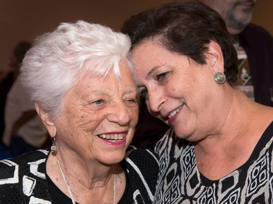 """Barbara """"Mother"""" Hubbard gets a heartfelt hug from Ana Mangino Thursday evening at the New Mexico Heritage Farm & Ranch Heritage Museum at a celebration of her 90th birthday on Thursday, July 27."""