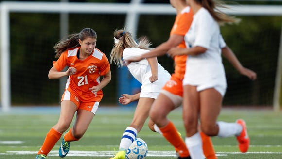 Horace Greeley's Samantha Forster (21) works the ball