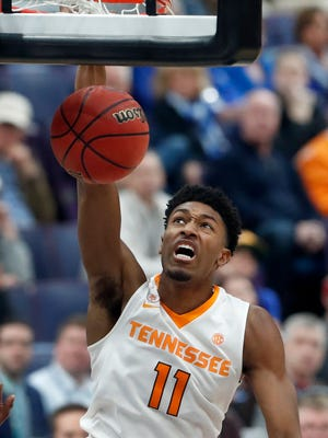 Tennessee's Kyle Alexander dunks during the second half of an NCAA college basketball game against Arkansas in the semifinals of the Southeastern Conference tournament Saturday, March 10, 2018, in St. Louis.  Tennessee won 84-66. (AP Photo/Jeff Roberson)