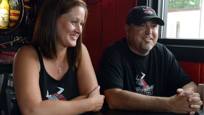 Owners Corry Hazen and Regan Kinder talk about their bar, the Angry Bull Saloon located on Linden Avenue in Zanesville. Hazen is part of a group that is bringing the AMA Flat Track All-Star Series to the Muskingum County Fairgrounds.