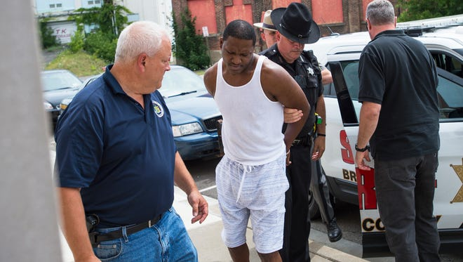 """Terence """"Money"""" Wise is led into Johnson City Village Court after police executed an early-morning drug raid July 28 in Endwell."""