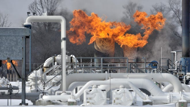 Fire comes out of the top of two silo-looking structures Jan. 30, 2019, at the compressor station at Consumers Energy in Armada Township.