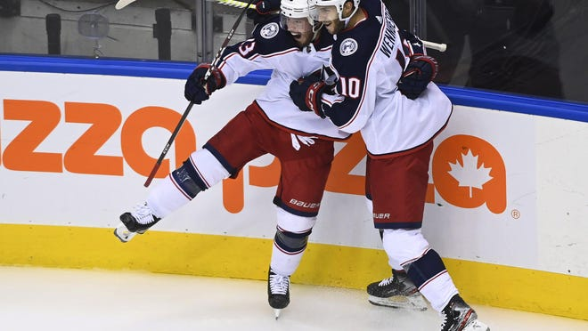 Cam Atkinson, left, and Alexander Wennberg celebrate Atkinson's goal in the third period.