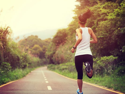 young fitness woman runner  running at forest trail